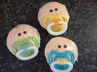 Cute cupcakes for a baby shower. Use real pacifiers.