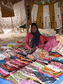 Woman from a project sponsored by Womens Interlink Foundation. The group makes blankets, sheets, saris and bags in the traditional kantha stitching design.