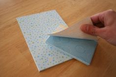 You can make your own tear-off note pad!  You can use this technique with a stack of business cards... keeps them together and easy to handle :)