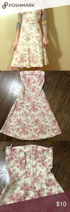 Toile print strapless dress This dress is made of a soft stretchy canvas like material. It hugs your form, but still has shape to it. Teeze Me Dresses