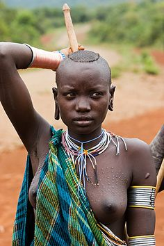 Africa | Young Surma woman attending the Donga stick fighting | © Johan Gerrits, via Flickr