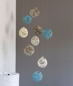 Decorative Yarn Spheres - If you can wrap yarn around a balloon, you can create these beautiful decorative spheres. Perfect in any color you desire, you can hang them in a stunning bunch from the ceiling, or collect them in a glass container.