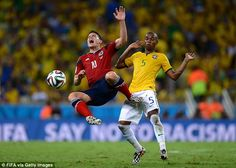 Upended: Rodriguez is barged into the air by Fernandinho during the first half of their World Cup quarter final 2014 Ouch: James Rodriguez was targeted by Brazil as Fernandinho brings Colombia's No10 down...