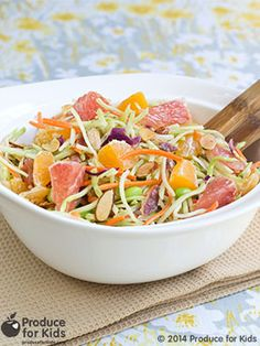 Citrus Asian Slaw - This Citrus Asian Broccoli Slaw can be made up to three days in advance (wait to add almonds until just before serving for the most crunch) and pairs well alongside our Asian Pulled Pork Sliders, Chicken Veggie Wraps or Hidden Veggie Meatballs. #glutenfree #dairyfree #ProduceforKids #recipe #healthy
