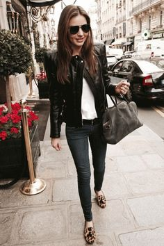 Miranda wears a leather jacket, dark skinny jeans, and a touch of animal print in her loafers.