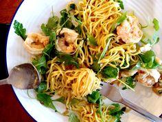 Homemade saffron spaghetti, prawns, rocket