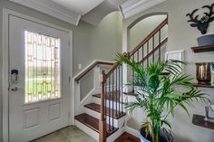 Traditional Staircase with Delray Plants 9-1/4 in. Areca Palm in Pot, High ceiling, Hardwood floors, Wainscoting