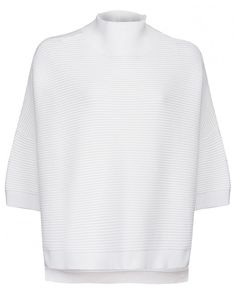 An oversized boxy knitted jumper, made from soft and stretchy cotton. It features a high ribbed funnel neck, ribbing detail on body and arms and a stepped hem at the back.