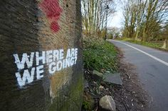 Graffiti on a wall in Lancaster, England, a town devastated by poverty and floods.