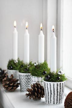 Centro de mesa con velas en maceteros