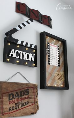 Decorate your family room with movie theater themed decor for a fun mini theater room experience! Fun movie room wall art, zombie pillows, a real popcorn maker and even candy and snacks make this room a fun place for family movie night. Thanks Wayfair! Deco Cinema, Cinema Room, Theatre Rooms, Movie Theater Decor, Home Theater Seating, Vintage Movie Theater, Tiny Movie, Family Room Design, Home Movies