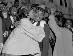 The Rev. Martin Luther King Jr. is welcomed with a kiss by his wife Coretta after leaving court in Montgomery, Ala., March 22, 1956. King was found guilty of conspiracy to boycott city buses in a campaign to desegregate the bus system, but a judge suspended his $ 500 fine pending appeal. (AP Photo/Gene Herrick) Photo: Gene Herrick, STF / Beaumont
