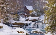 Mills: Landscape Photography  Photo of snow-covered mill. Water continues to flow beneath Glade Creek Grist Mill despite the fallen snow. Photography by T.R. McClellan.