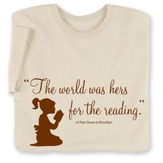 The World Was Hers For The Reading Short-Sleeved Tee  EXCLUSIVE! In Betty Smith's cherished coming-of-age novel, A Tree Grows in Brooklyn, Francie Nolan's life changes forever when she discovers books. Shirt for women (and girls) who love books and reading as much as Francie did. $22.95. signals.com