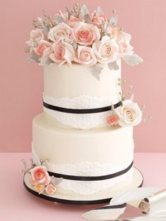 timeless wedding cake~ I would opt for differs flowers and a taller cake and there would be ribbons and pearls but I like the lace