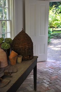 the bee skep is beautiful.  also love the herringbone pattern of the bricks on the floor.
