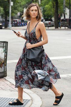Jessica Alba in a printed maxi dress, Birkenstocks, and a crossbody bag