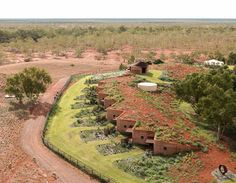 Composed of 230m of simple, natural materials, this earthen structure may look unassuming, yet it is actually the longest rammed earth wall in Australia. Built to accommodate cattle workers during mustering season in the scorching Western Australia outback, Australia.