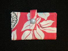 I love this style of wallet. It's actually what I carry every day. It securely holds your cards, money and essentials without taking up too much room in your pocket or purse.