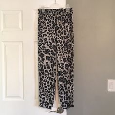 Michael Michael Kors joggers Black and grey cheetah print joggers. These are the perfect pair of statement pants. Size 2 MICHAEL Michael Kors Pants Track Pants & Joggers