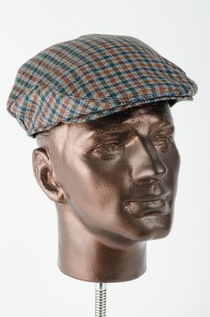 44a1bfc0357 This beautifully textured staple flat cap is produced from a delicate wool  in a green