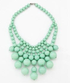 aqua bead necklace under crisp white shirt...lots of colors work.