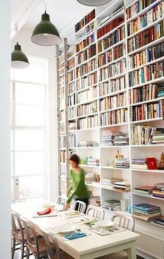 Book storage solutions from apartment therapy.  I wish our ceilings are this tall when we buy our house.
