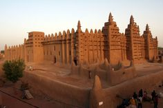 Timbuktu, Mali -- This mosque is the largest mud building in the world.  Every year, after the rainy season and as part of a celebration, residents get together to reapply mud to the outside.  Because it is the nature of the material to wash away in the rain, there is constant upkeep.