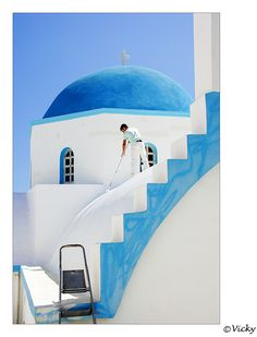 painting the church, Naxos Greece by Vicky Dens