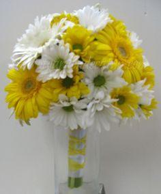 Yellow Gerbera Daisy, White Gerbera Daisy, Yellow Daisy, and White Daisy make up this bright and cheerful bridal bouquet.