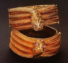 "A pair of ""snake"" bracelets ('galang ular'), from the Minangkabau, West Sumatra, Indonesia. Gold and rubies. Shown in Bruce Carpenter e.a., *Ethnic Jewellery from Indonesia*, p. 104."