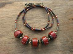 Colorful yet earthy Boho necklace using brick red jasper beads accented by shiny golden brass. The red pops nicely while the