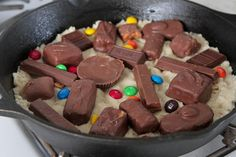 What to do with all that Halloween candy .... Skillet Baked Candy Bar Stuffed Double Cookie