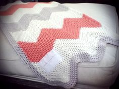 chevron crochet baby blanket in coral, silver and off white