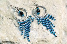 Original ethnic style earrings, made ​​of beads of multiple colors and light metal fittings, decorated with multi-faceted oval bead in the center, which creates the effect of the pupil. The product goes well with both light summer blouses and pullovers warm autumn. Stylish and elegant, they are ...