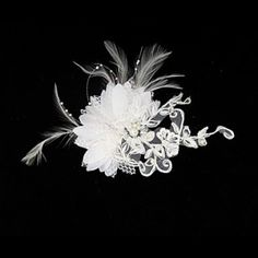 Gorgeous Satin/ Lace Wedding Bridal Headpiece Lace flower with feather headdress This fabric and feather headpiece is whimsical. It has a ragged appearance with pearl trim.  Great hair jewellery   10cm x 10cm x 10cm  Postage costs apply  BUDGET BRIDAL
