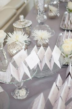 Silver and white escort card display.