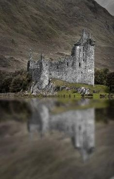 Kilchurn Castle ~ is a ruined 15th and 17th century structure on a rocky peninsula at the northeastern end of Loch Awe, in Argyll and Bute, Scotland. Access to the Castle is sometimes restricted by higher-than-usual levels of water in the Loch. by jolene