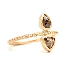 Showcasing two uniquely cut diamonds, our Double Diamond Rose Cut Pavé ring joins a pear & a triangle on a delicate pavé band. 1.01ctw on 14k yellow gold.