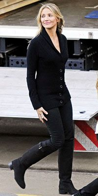 Cameron Diaz topped her skinny jeans and knee-high boots with a cardigan worn as a shirt.