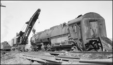 """Date: March 09, 1946 Location: Drummond, MT Photographer: Ron V. Nixon Railroad: Northern Pacific Railway Caption: """"Extra 5121 West rear-ended the main line local, Extra 1816 West, at Drummon, MT. --- USA"""
