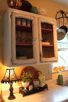 love the chicken wire cupboard and pot hanger