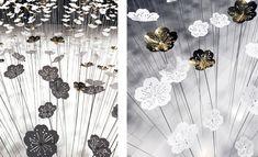 « Jardin d'Hiver » est une carte blanche confiée à Soline d'Aboville par Procédés Chénel pour fêter la fin de l'année : l'installation met en scène 300 fleurs blanches et or qui se reflètent à l'infini dans trois miroirs pour constituer un paysage immersif et onirique.