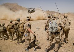 Afghan National Army commandos from the Special Operations Kandak and coalition forces (SEALs) during a village clearing operation in Shah Wali Kot district, Kandahar province, Afghanistan, Aug.