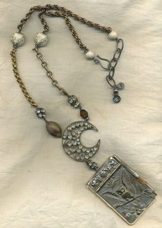 Owl Moon--- Antique Assemblage Necklace With Old Owl Message Book and Paste Moon. $190.00, via Etsy.