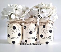 Painted polka dot Mason Jars. Perfect for a nursery, as a centerpiece, etc! Available on Etsy. Click image to browse the shop!