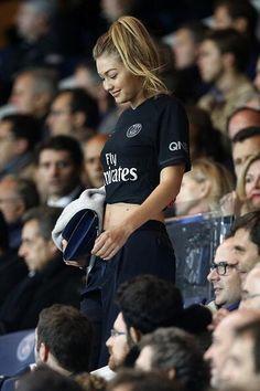 Gigi Hadid wearing Nike Paris Saint-Germain Dark Light Match Soccer Jersey and Michino Paris Phedra Clutch
