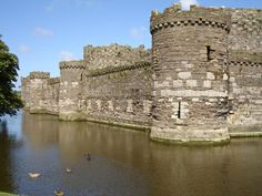Wales - Beaumaris Castle is a medieval castle on the Isle of Anglesey built by King Edward I. Begun in 1295, this was the last of the king's ring of castles which he commissioned so as to affirm his conquest of Wales. Designed to be the largest of this imposing circle, it was never completed. Despite that, it did play a military role, being besieged and captured by Prince of Wales Owain Glyn Dwron in 1403 before being retaken by the English in 1405.