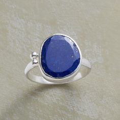 INKBLOT RING--In our artisan lapis and sterling silver ring, inky blue lapis flows smoothly to fill its irregular bezel, dotted on one side with granulation beads. Handcrafted in sterling silver exclusively for Sundance. Whole sizes 5 to 10.