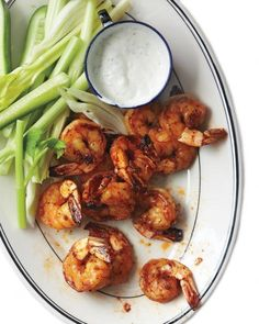 Roasted Buffalo Shrimp Recipe.  Replace Martha's seasonings with Frank's Red Hot Sauce for a low carb version-serve with blue cheese dressing.
